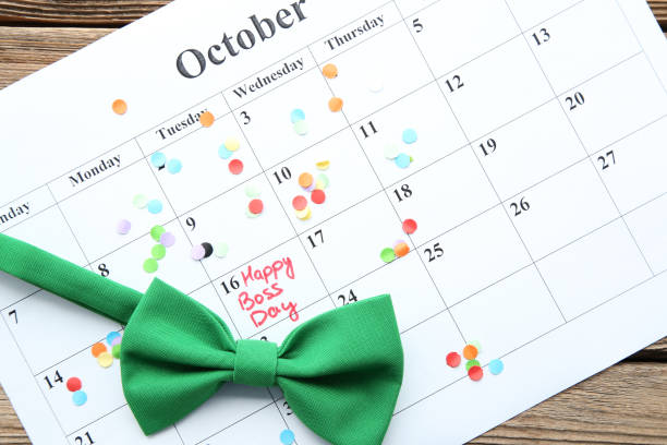 Inscription Happy Boss Day in calendar with bow tie and confetti Inscription Happy Boss Day in calendar with bow tie and confetti boss's day stock pictures, royalty-free photos & images