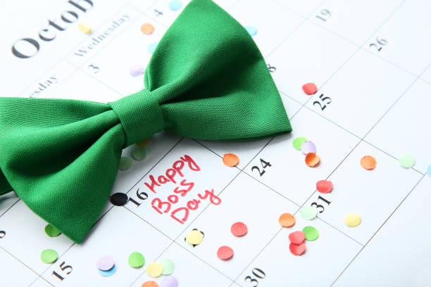 Inscription Happy Boss Day in calendar with confetti and bow tie Inscription Happy Boss Day in calendar with confetti and bow tie boss's day stock pictures, royalty-free photos & images