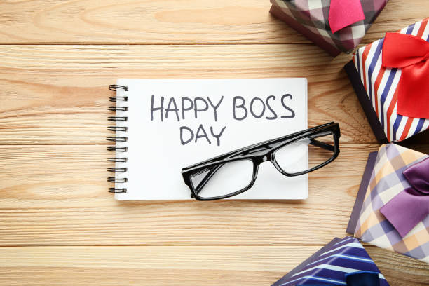 Inscription Happy Boss Day in notebook with gift boxes and glasses Inscription Happy Boss Day in notebook with gift boxes and glasses boss's day stock pictures, royalty-free photos & images