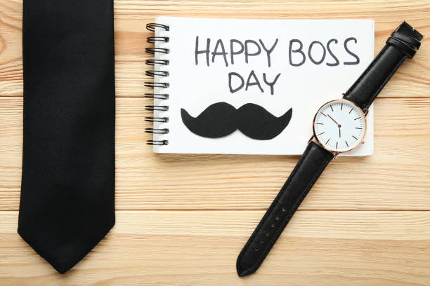 Inscription Happy Boss Day in notebook with wrist watch and tie Inscription Happy Boss Day in notebook with wrist watch and tie boss's day stock pictures, royalty-free photos & images