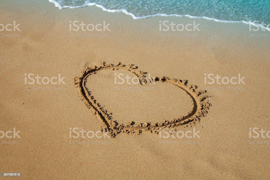 inscription heart on beach sand stock photo
