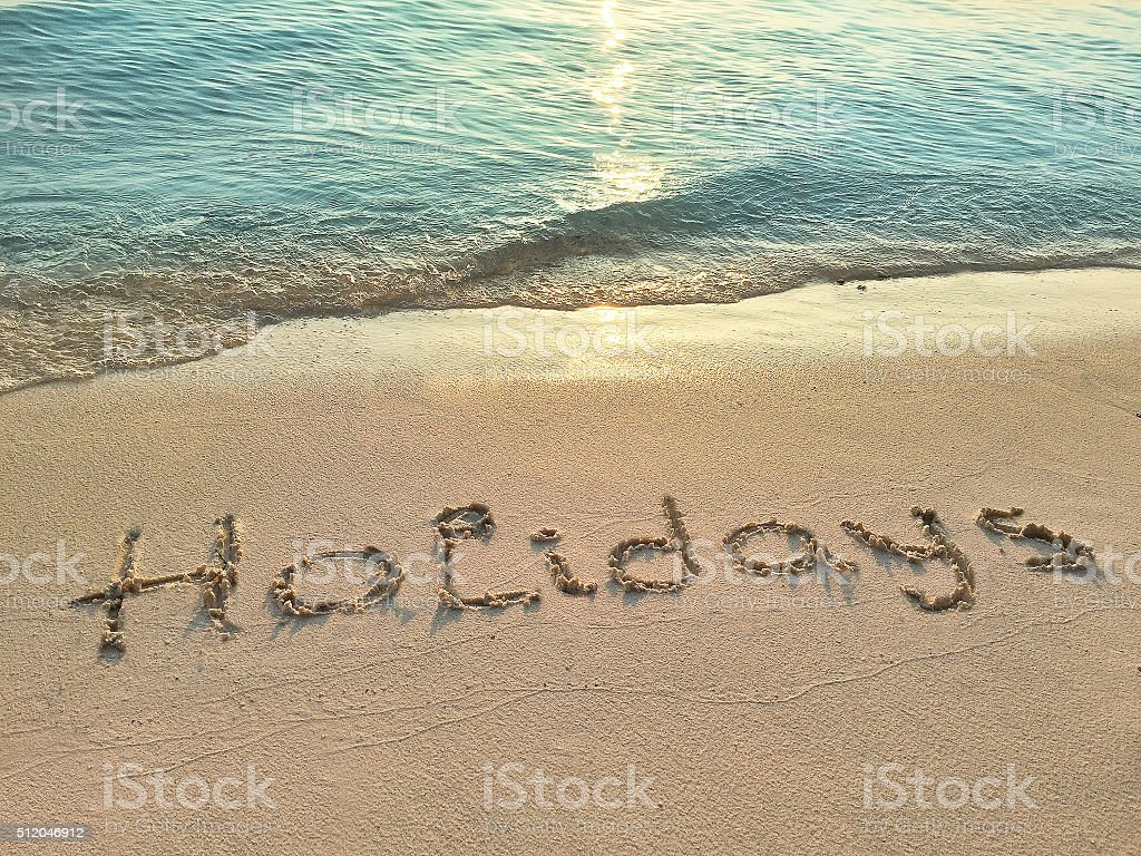 Inscription in the sand on a tropical island stock photo