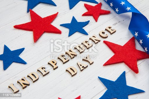 istock Inscription Independence Day on wooden white background 1137109984