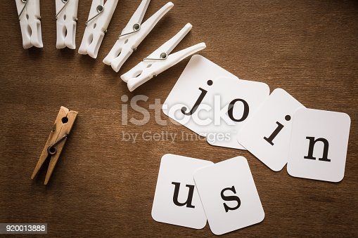 istock Inscription join us on the brown wooden desk. Team searching person for creating new talent. In trainings, seminars, courses can improve skills or discover something new. Improvement concept. 920013888