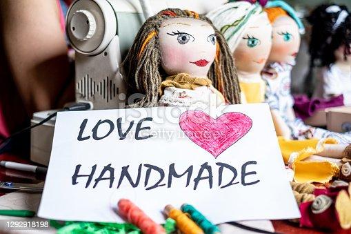istock Inscription love handmade with rag dolls 1292918198