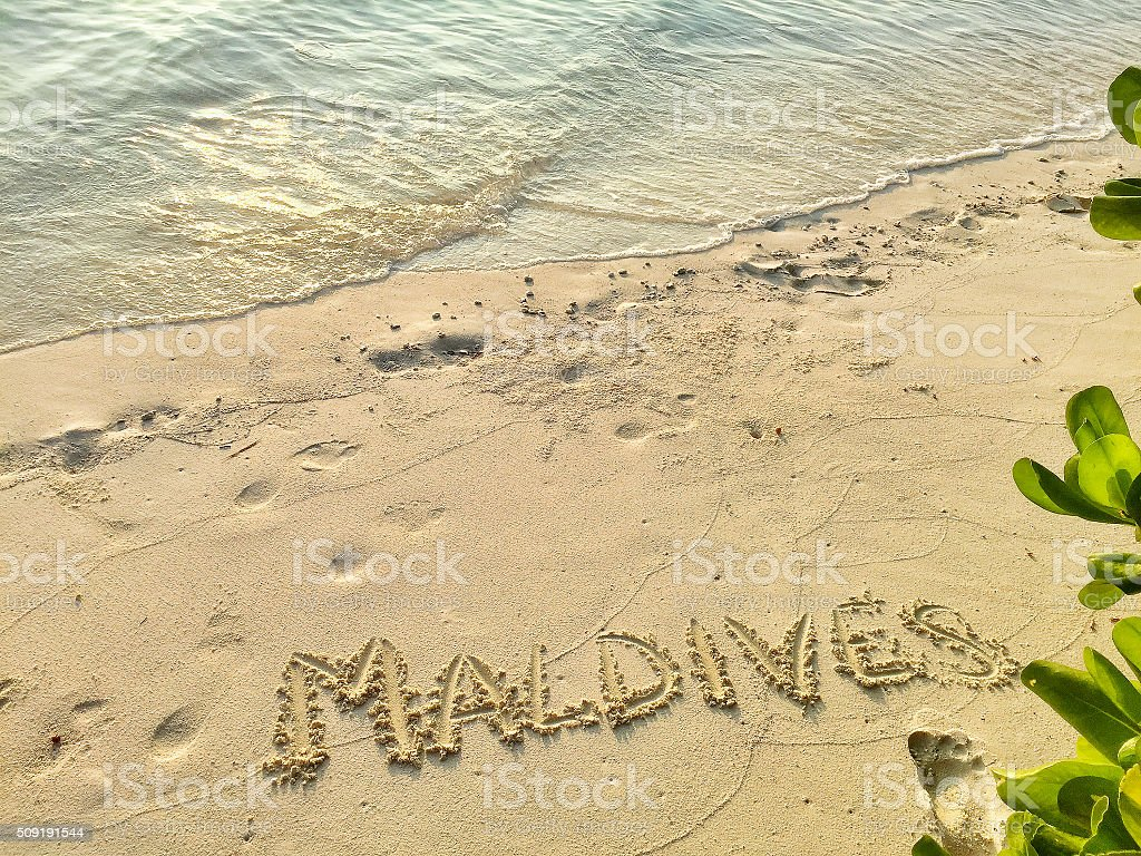 Inscription Maldives In The Sand On A Tropical Island Maldiv Stock