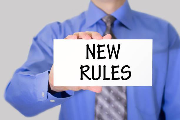 inscription new rules stock photo
