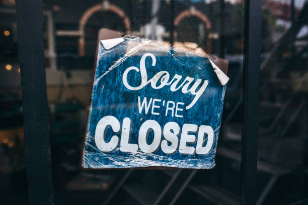 inscription on a door: sorry we are closed. conceptual photo or table on door with information of work. announcement or work schedule - closed stock pictures, royalty-free photos & images