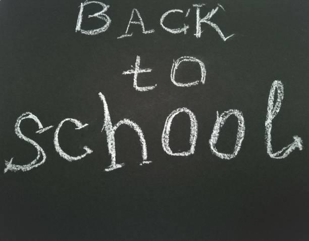 Inscription on shcool blackboard Back to school. stock photo