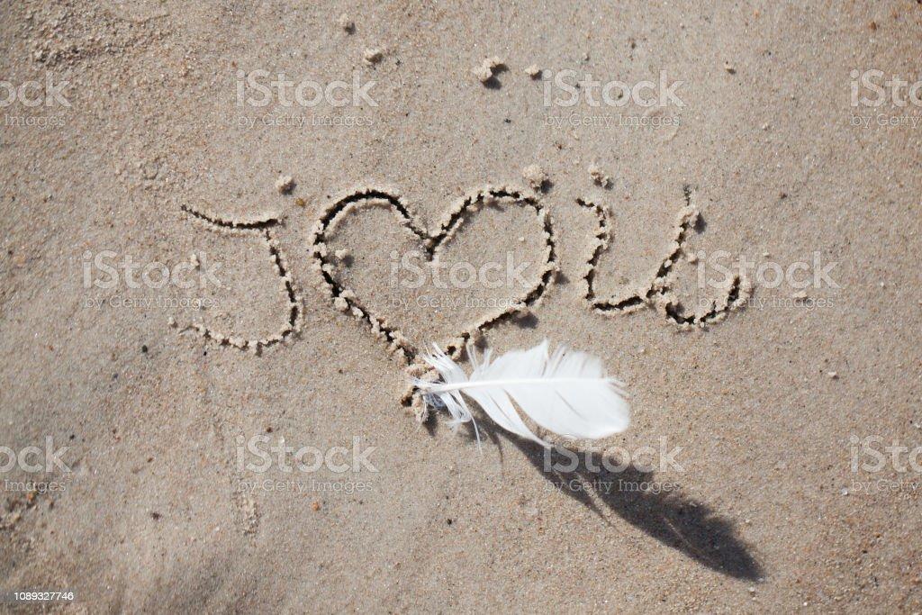inscription on the beach 'i love you'. holiday, beach, inscription on the sand, stock photo