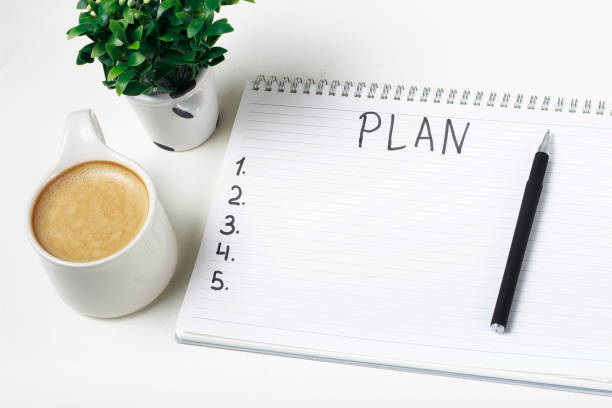 Inscription Plan in notepad, close-up, top view, concept of planning, goal setting stock photo