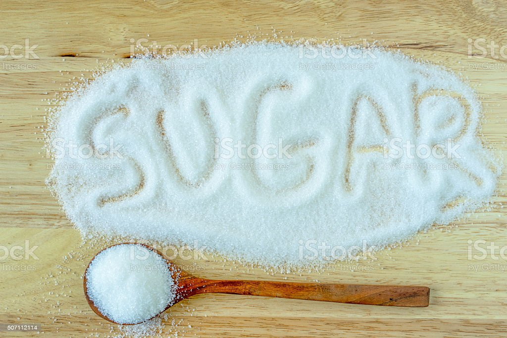 Inscription sugar made into pile of white granulated sugar. stock photo