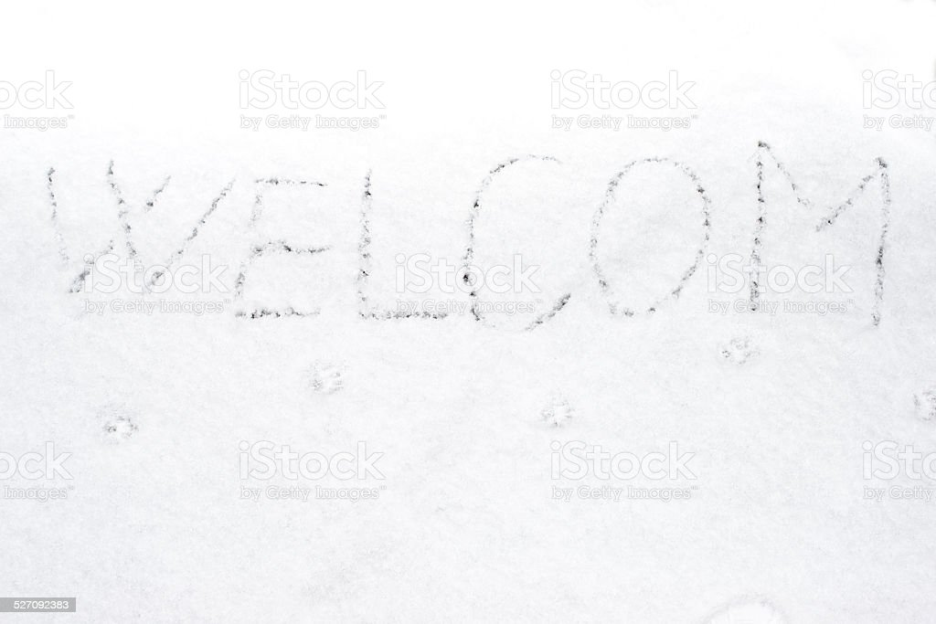 inscription welcom on snow-covered ice stock photo