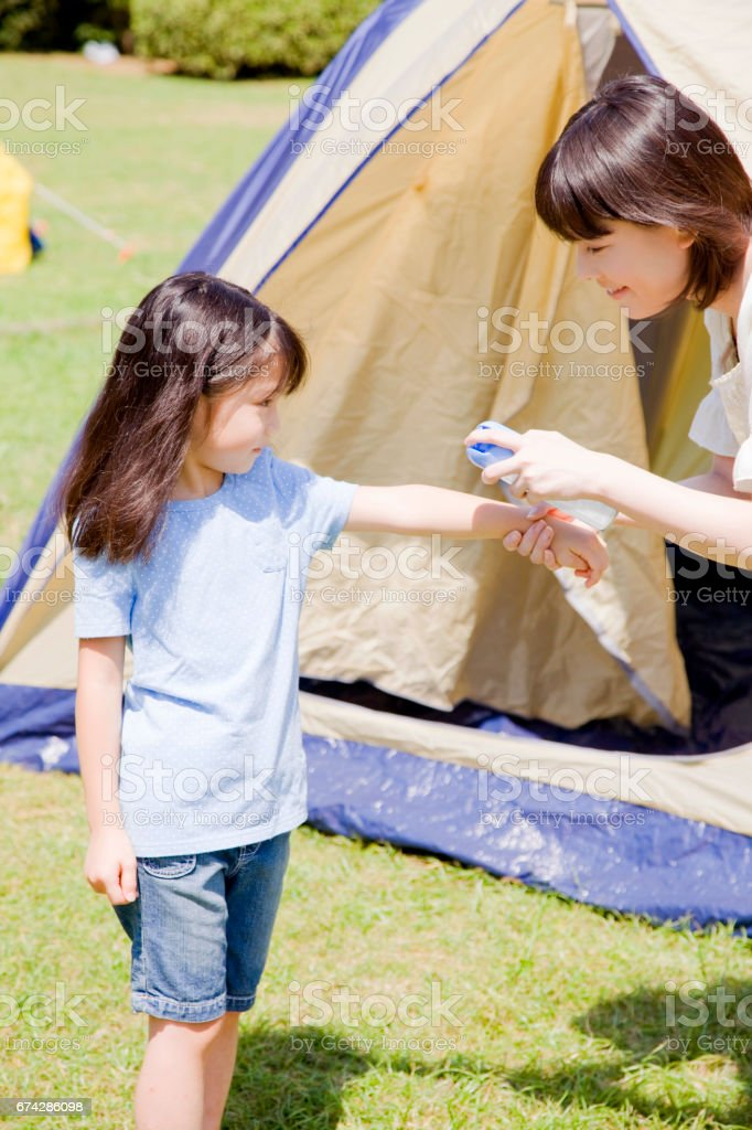 Insect repellent spray to her mother stock photo