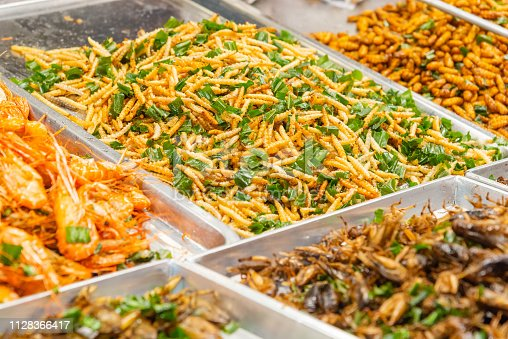 istock Insects food - Deep Fired Insects at street food market in Bangkok, Thailand 1128366417