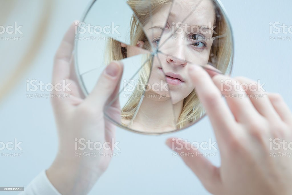 Insecure pretty woman stock photo