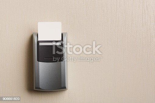 istock Insert key card in electronic lock in hotel 906661820