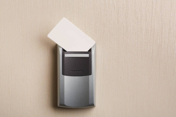 Insert key card in electronic lock in hotel Insert key card in electronic lock in hotel. Room service security system, personal identification concept, copy space cardkey stock pictures, royalty-free photos & images