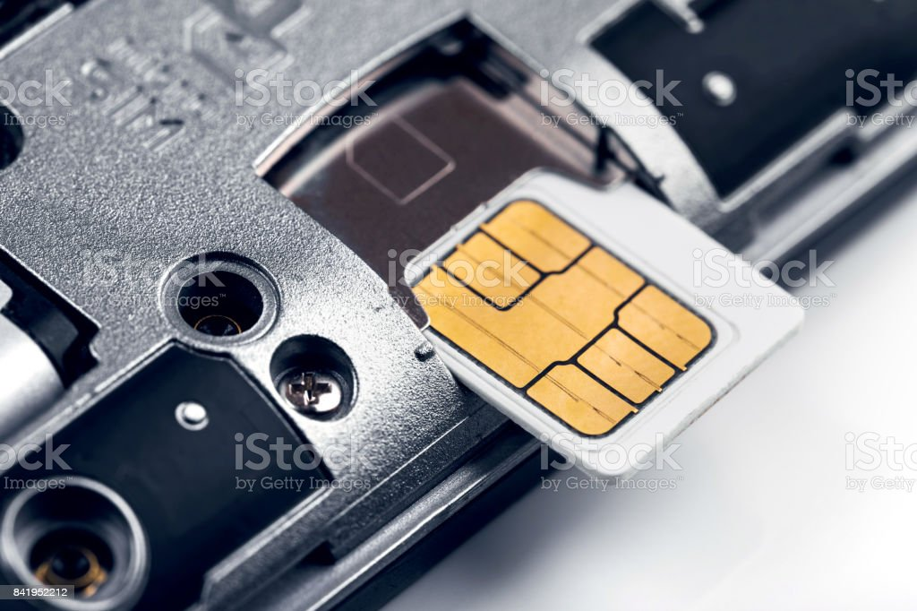 insert sim card in smart phone stock photo