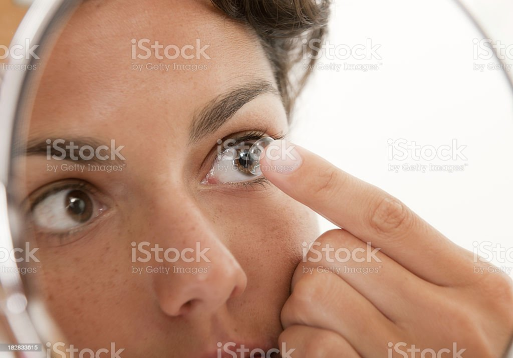 Inserting a Contact Lens in the Eye (XXXL) royalty-free stock photo