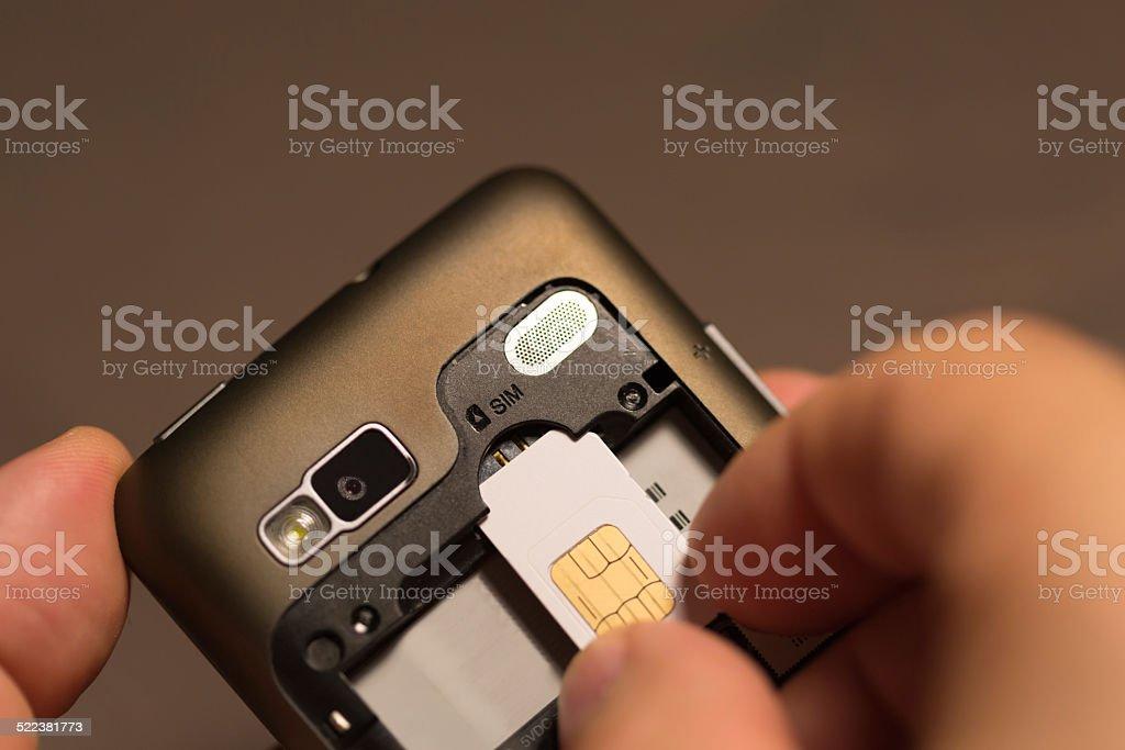 Inserting a sim card stock photo
