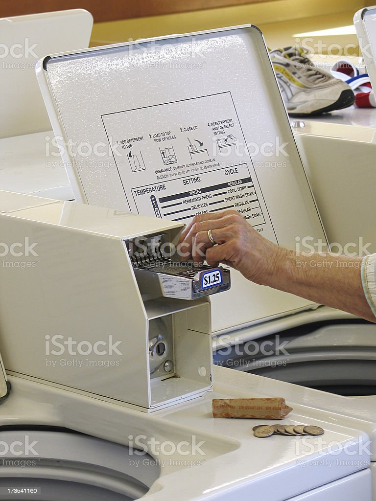 Inserting Coins at Laundromat royalty-free stock photo