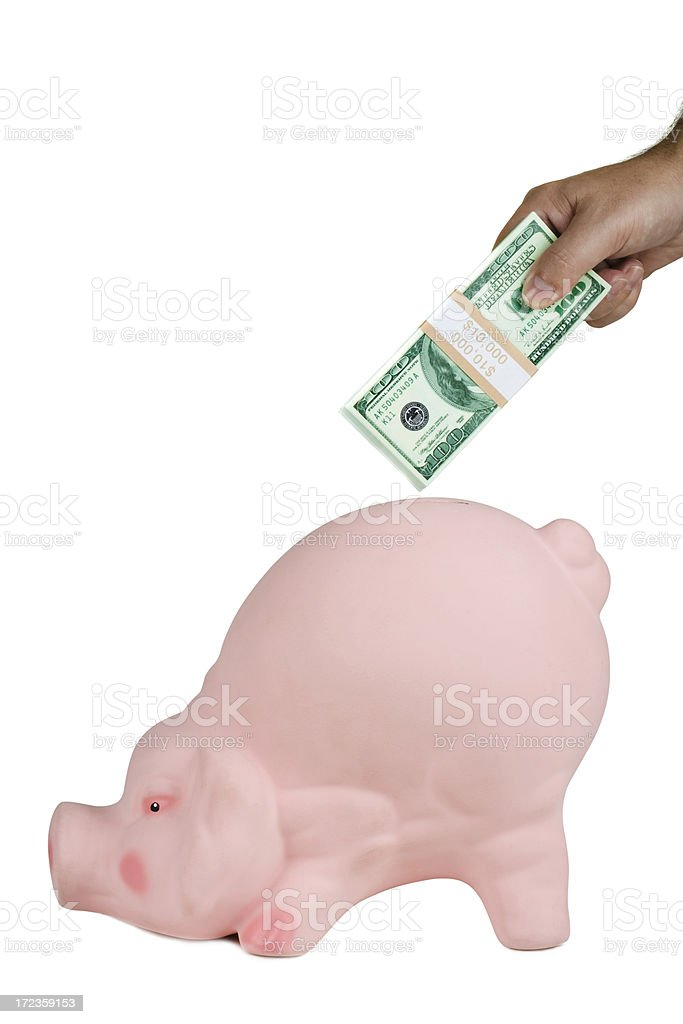Inserting money to piggy bank royalty-free stock photo