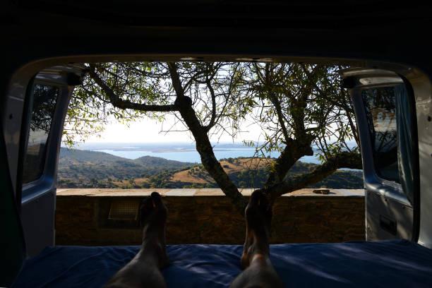 Inside a campervan looking at nice landscape of Monsaraz in Alentejo, Portugal stock photo