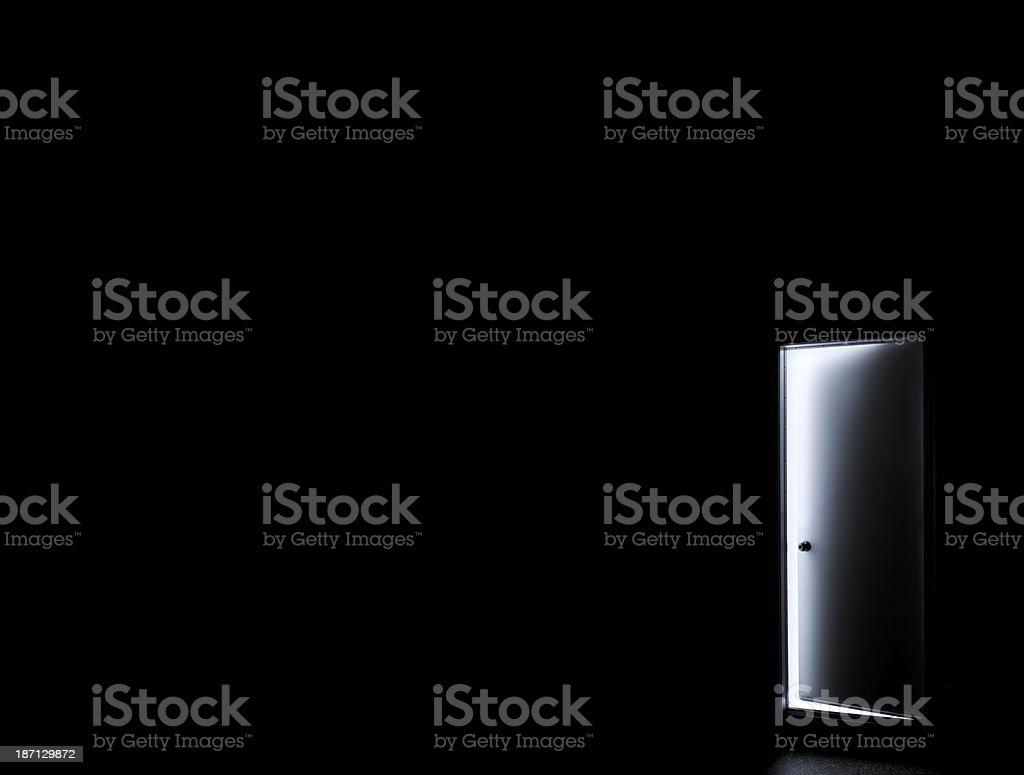 Inside a dark room with opened door stock photo