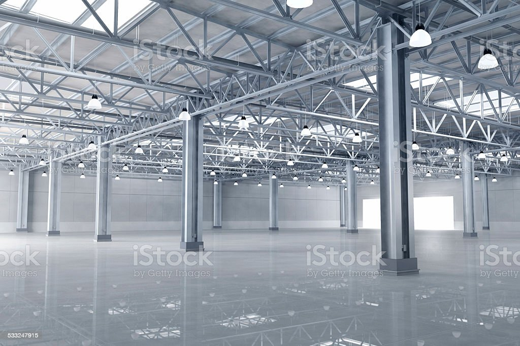 Inside a large empty new warehouse building stock photo
