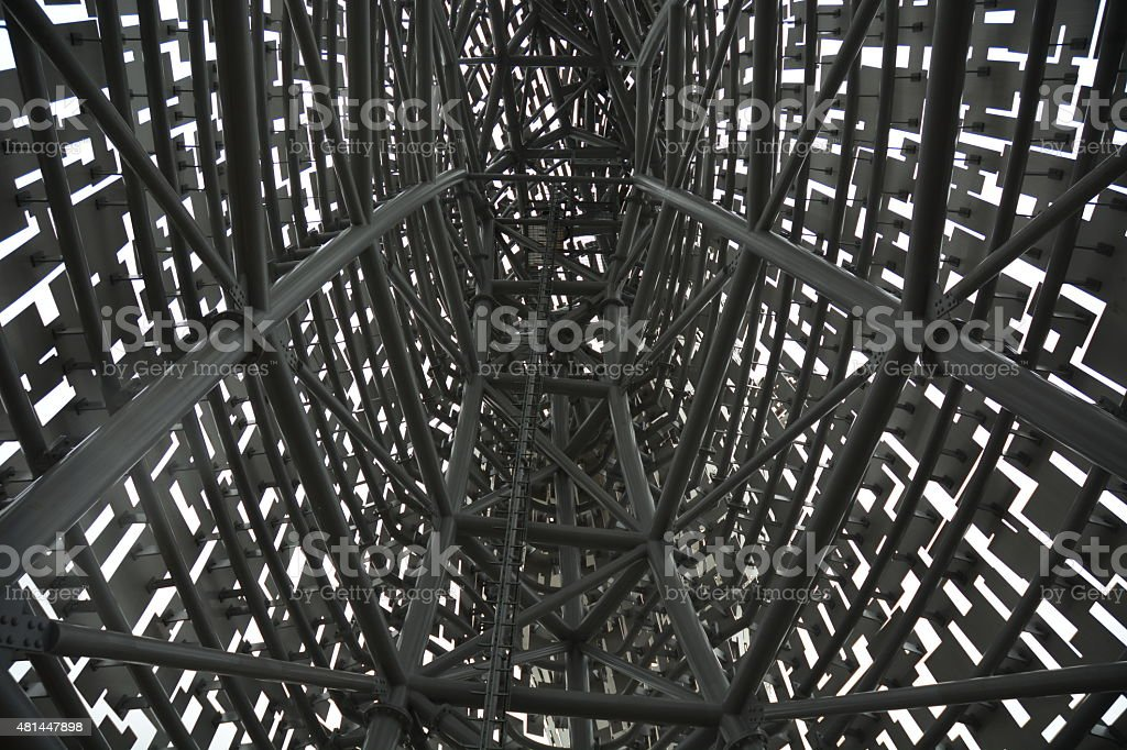 Inside a metal structure looking at the steelwork stock photo