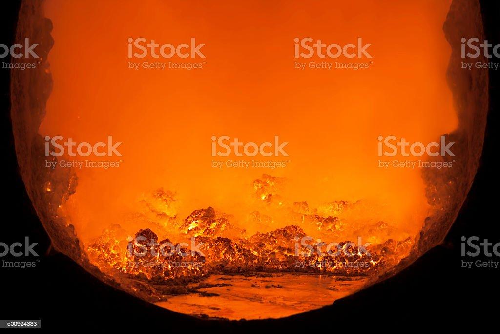 Inside a molten metal furnace. stock photo