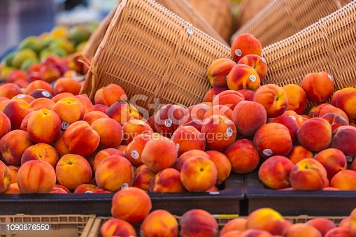 Inside a supermarket with peaches