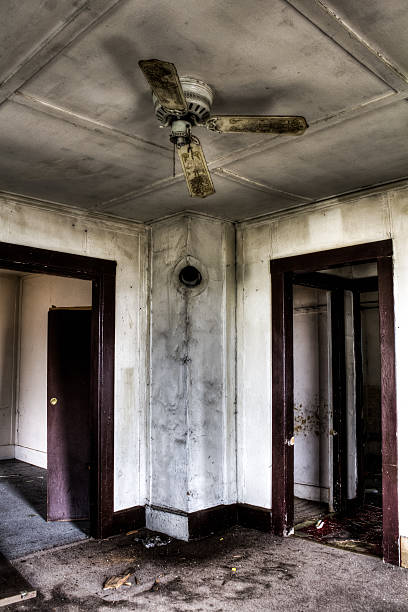 Royalty free broken ceiling fan pictures images and stock photos ceiling fan repair stock photo inside an abandoned house stock photo mozeypictures Images