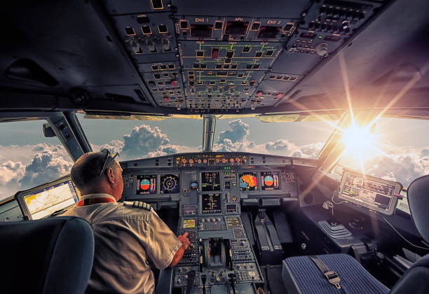 Inside an aircraft September 2016 - In The Air, French airspace - The cockpit of an Airbus A320 in flight pilot stock pictures, royalty-free photos & images