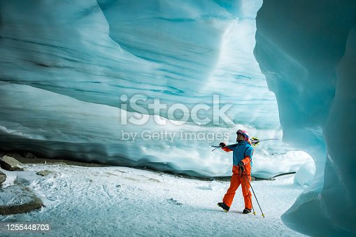 Women exploring an ice cave. Wonders of nature. Immersed in natures beauty.
