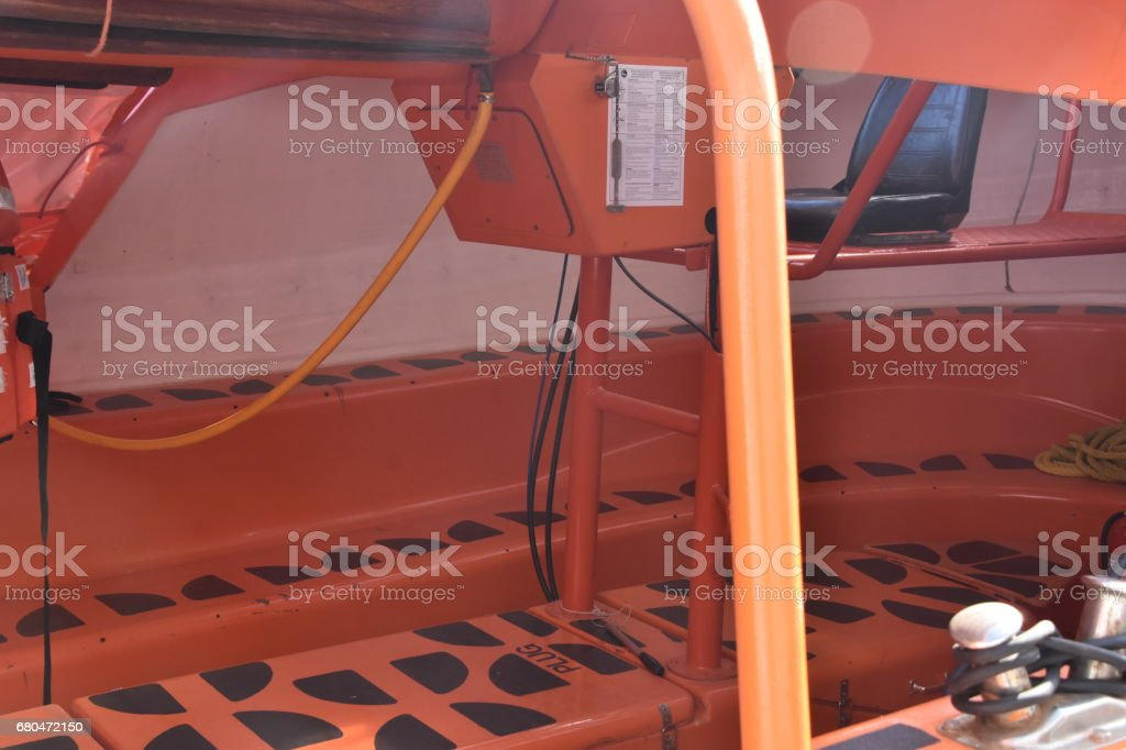 Inside an orange lifeboat stock photo