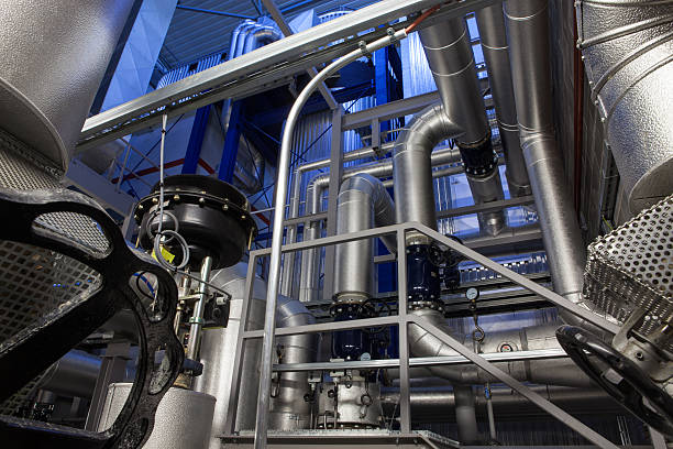 inside co generation power plant - cogeneration plant stock photos and pictures