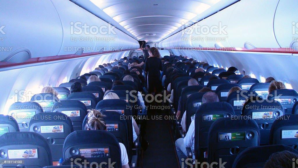 Inside Easyjet Airplane And Flight Attendantspeople Sitting Down