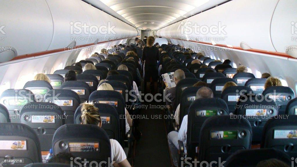 Inside Easyjet Passenger Airplane,People Sitting Down,Flight Attendants stock photo