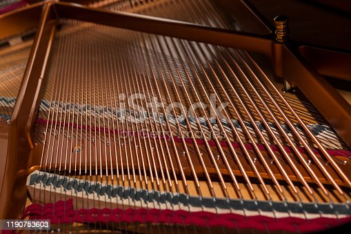 Inside grand piano with strings.