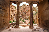 Tomb Ruins (Rock Columns and Large Entrance): View from inside a stone tomb in the Ancient City of Petra - Jordan