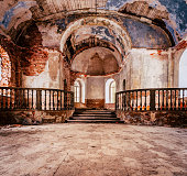 istock Inside Interior of an old Abandoned Church in Latvia, Galgauska - light Shining Through the Windows, Colorful Brown Theme 1291275516