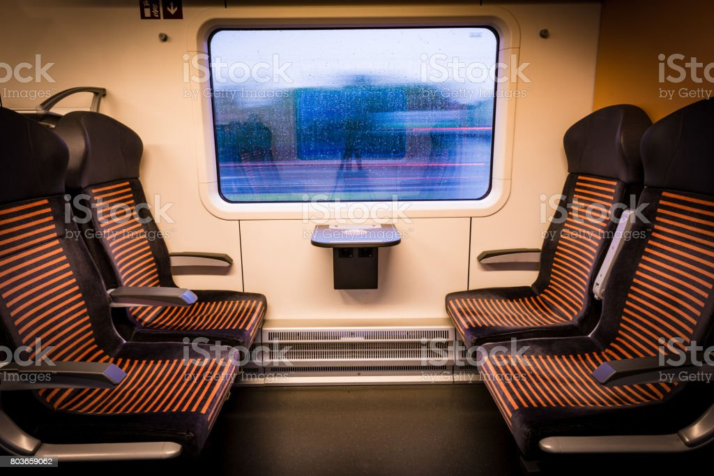 Inside modern train looking out of the window stock photo