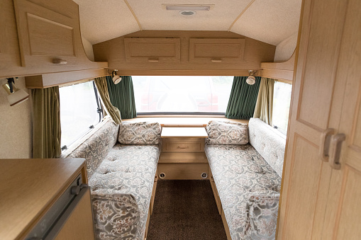 Inside Of A Caravan Showing The Seating Area Stock Photo - Download Image Now