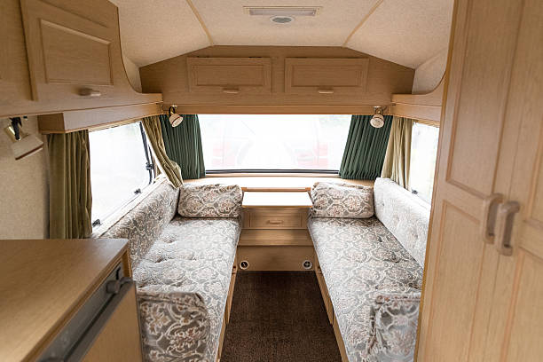 Inside of a caravan showing the seating area Interior of a caravan popular cheap family holiday home ideal for camping. rv interior stock pictures, royalty-free photos & images
