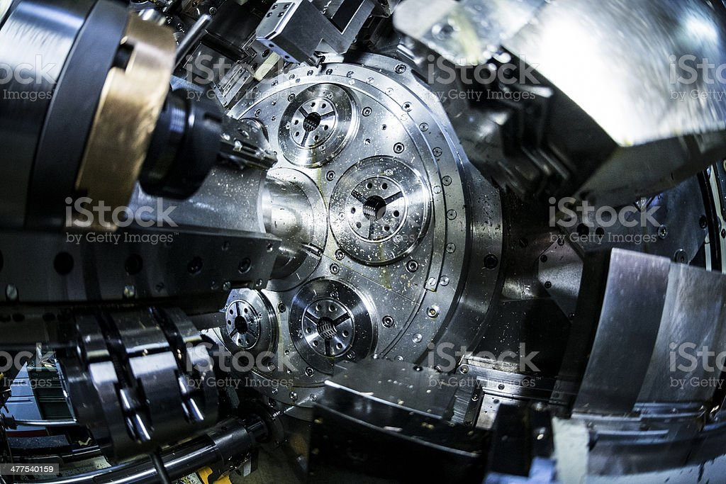 Inside of a CNC multi-spindle lathe machine stock photo