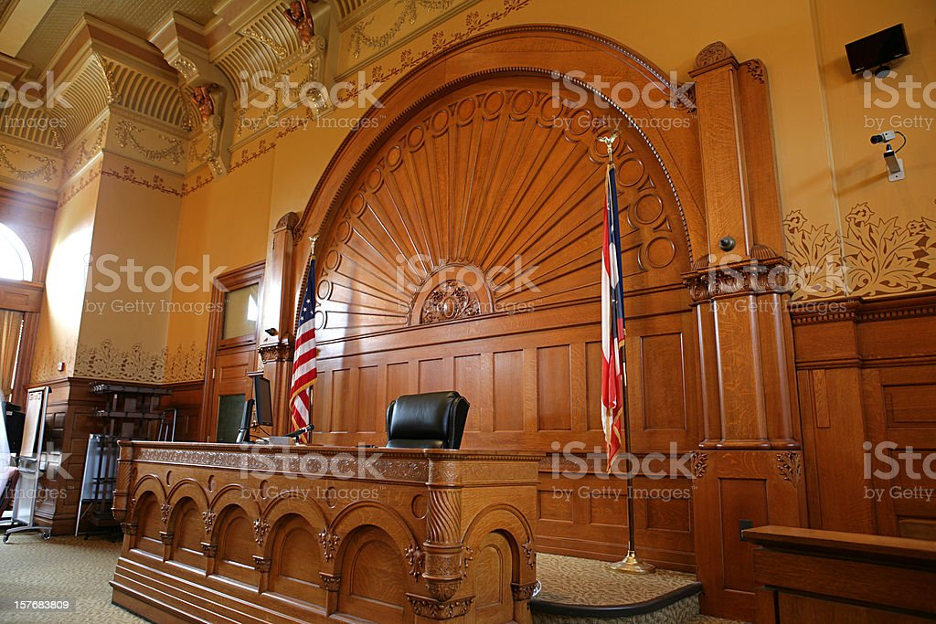 Inside of a courtroom with American flags royalty-free stock photo