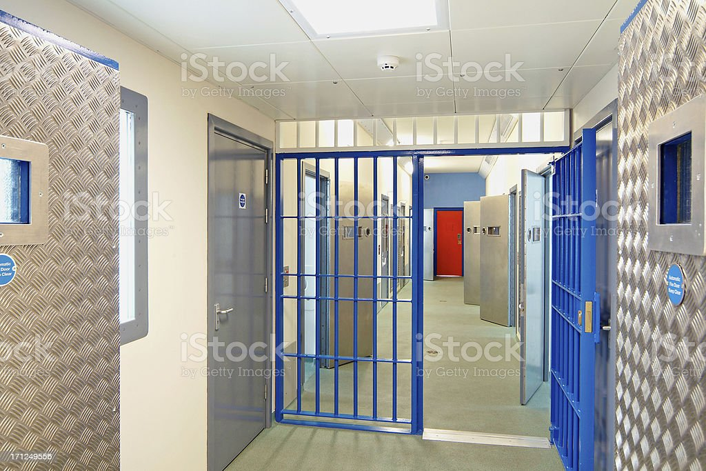 Inside of a modern prison with open doors royalty-free stock photo
