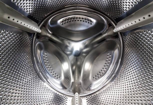 Inside of a washing machine drum stock photo
